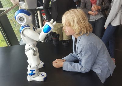 Children fascinated by robots